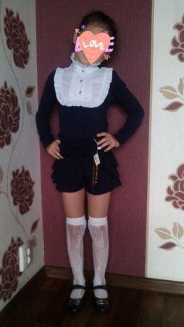 Продам школьную блузку на девочку и юбку шорты