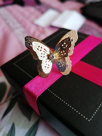 . Anel borboleta.