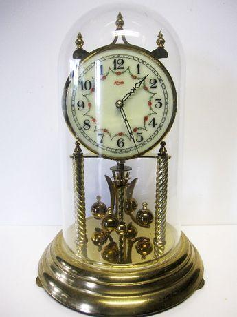 antigo Relógio anual de pêndulo rotativo KUNDO com redoma