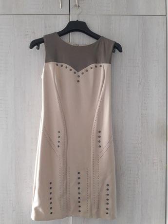 Piekna sukienka beżowa. Wstawka z ekoskóry