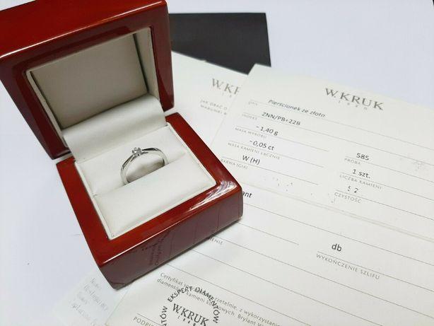 złoty pierścionek firmy kruk z brylantem z certyfikatem