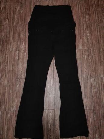 Черные джинсы клеш