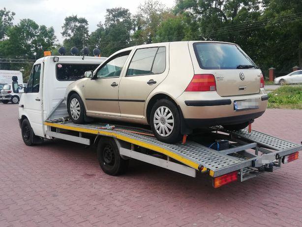 Pomoc drogowa holowanie laweta wciągarka transport aut maszyn wypadek