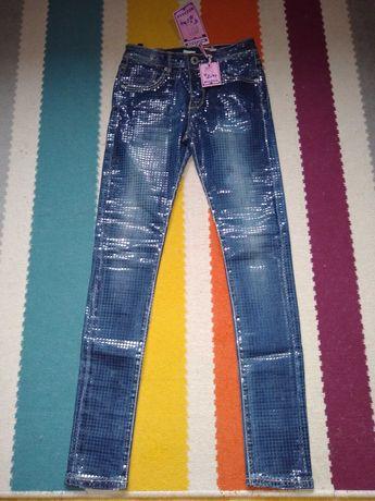 Nowe spodnie dziewczęce XS jeansowe z ozdobami