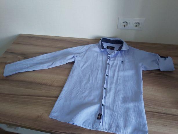 Продам школьную рубашку на мальчика