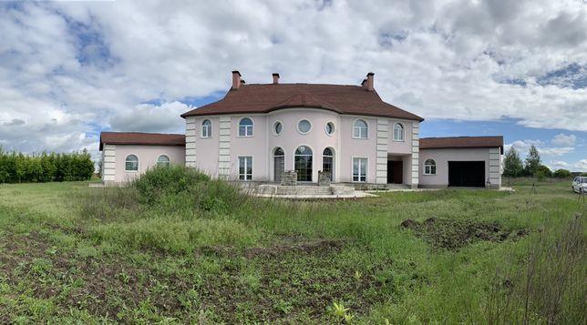 Дом с 1 га земли. Договорная