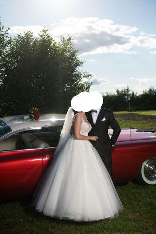 Piękna suknia ślubna z jednego z najlepszych salonów ślubnych w ZG
