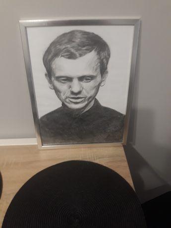 Obraz w srebrnej ramie Jerzego Popieluszki