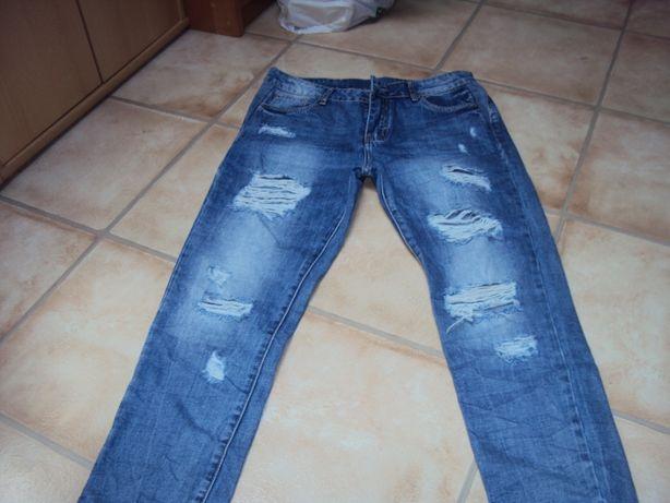 Spodnie dżinsy nowe dziury niebieskie 38/40 m/l