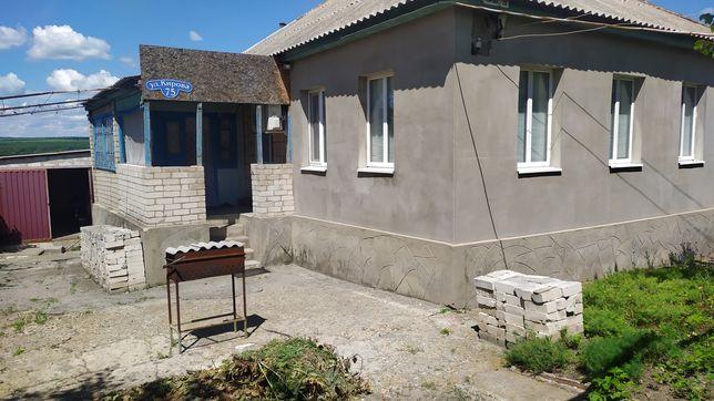Дом с гаражом и участком