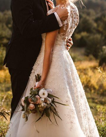 Śmietankowa / ivory suknia ślubna z efektownym tyłem