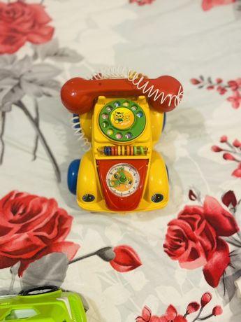 Игрушка машинка-сортер-телефон