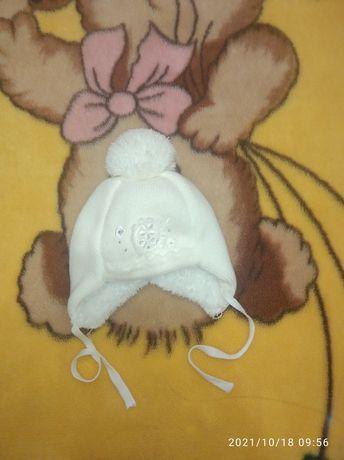 Продам зимнюю шапочку для новорожденных 36-38 размер
