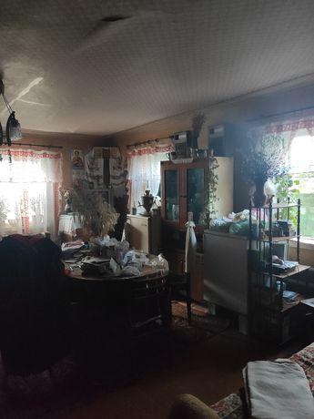 продам дом село Шебелинка с гаражами погребами сараями и огородом