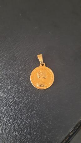 Dos pesos libra banhado a ouro