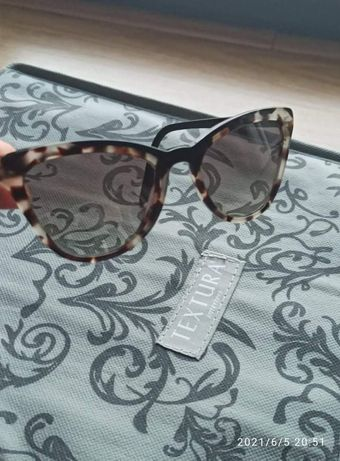Óculos sol Prada modelo pr01y