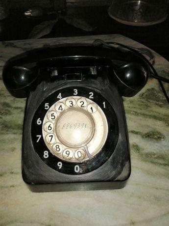 Telefone preto de disco antigo