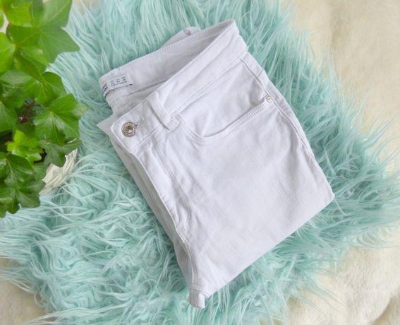 Białe spodnie jeansy Zara r. 40