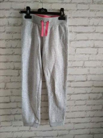 Dresy szare 128 dla dziewczynki ze ściągaczem jasne spodnie dresowe