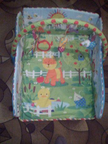 Развивающийся коврик для малыша