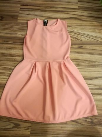 Sprzedam sukienkę brzoskwiniową rozmiar L