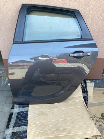 Opel Astra J HB Drzwi lewy tył Z177