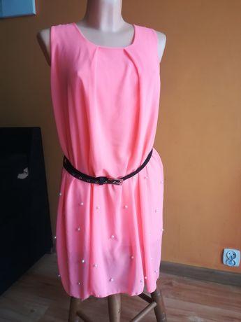 Nowa sukienka z perełkami może być ciążowa