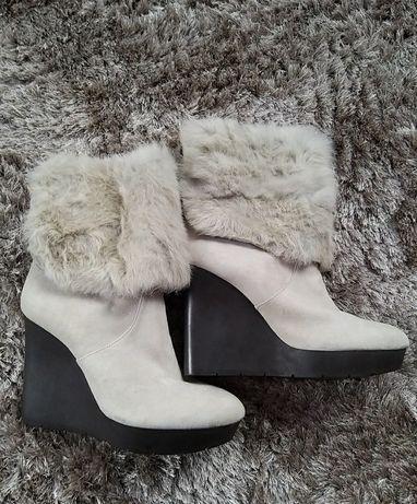 Зимові черевики.
