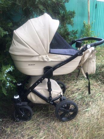 Детская коляска  Riko Natyro Ecco.