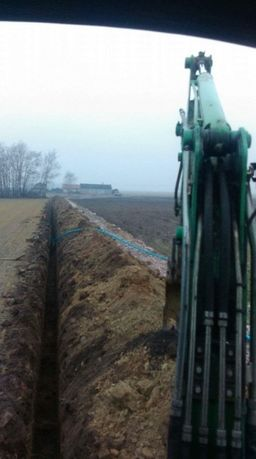 Usługi wodociągowe podłączenie wody przecisk pod drogą koparka nawiert