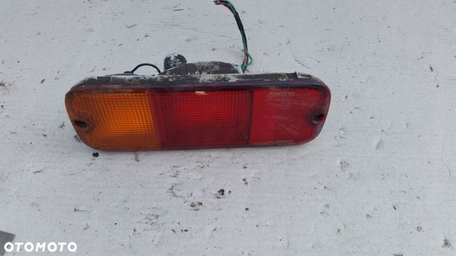 Lampa tył lewa w zderzak Suzuki Grand Vitara