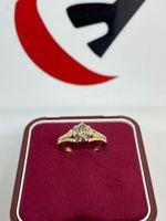Złoty pierścionek z brylantem 0.42ct