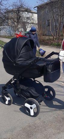 Дитяча коляска 3в1 в екошкірі