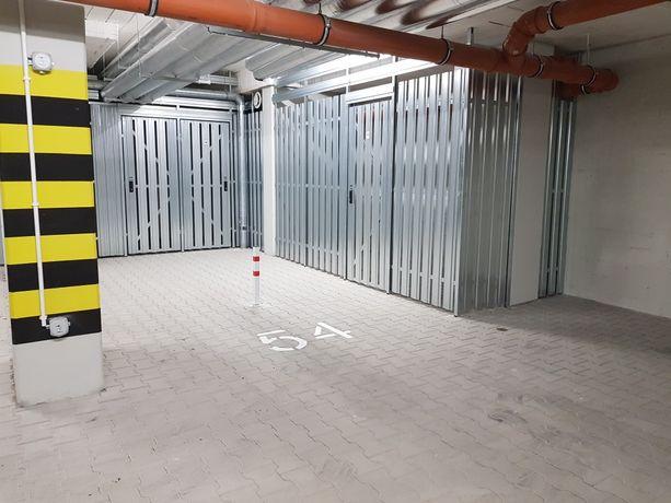 Miejsce postojowe w garażu podziemnym + duża komórka lokatorska 6m2