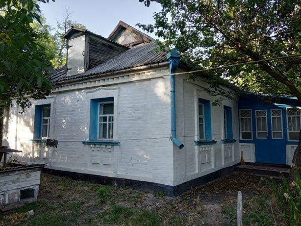 Продам хату з 2 гаражами, 2 льоха, 2 сараї, колодязь, свинарник