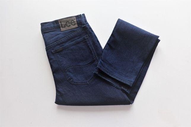 Męskie spodnie jeansy LEE CASH W31 L32 slim taper fit jak nowe okazja