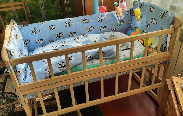 Дитяча кроватка .