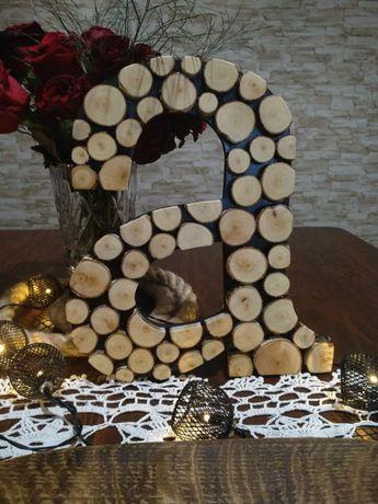 Drewniana literka a. Z brzozowych plasterkow. Recznie wykonana.