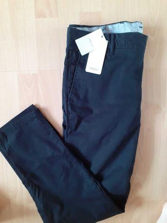 Nowr eleganckie spodnie romziar 44 MANGO