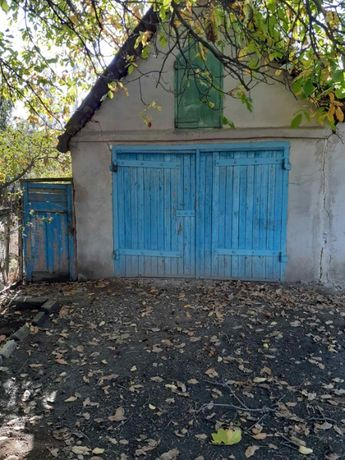 Продается гараж с приусадебным участком