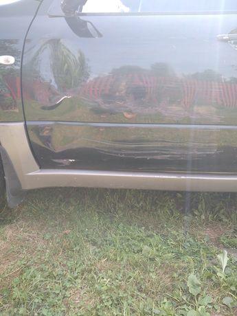 Передня ліва дверка на Міцубісі Аутлендер 1 2003р.