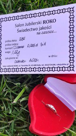 Złoty pierścionek z diamentem certyfikat