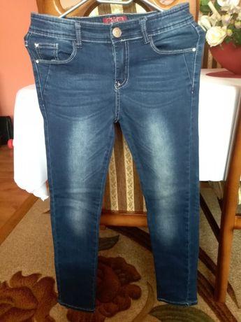 Spodnie jeansowe firmy reporter rozmiar XS.