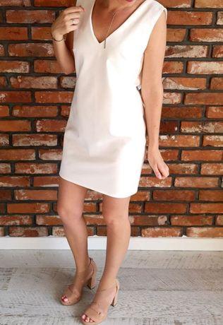 Biała sukienka z dekoletwm V