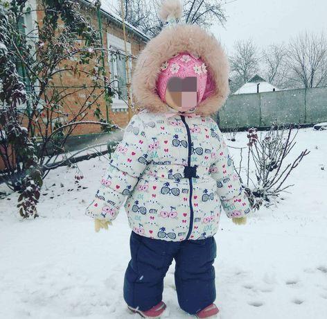Зимній комбінезон для дівчинки.