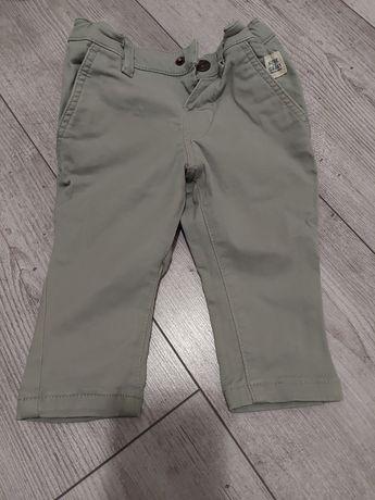 Oliwkowe jeansy H&M rozmiar 68
