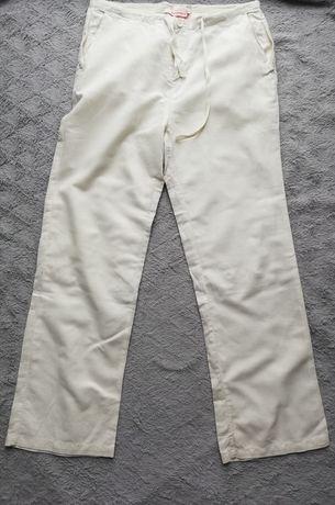 Kremowe spodnie na lato Quiosque