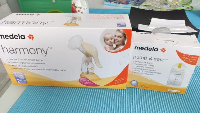 Молокоотсос Medela + пакеты для хранения молока + воронка