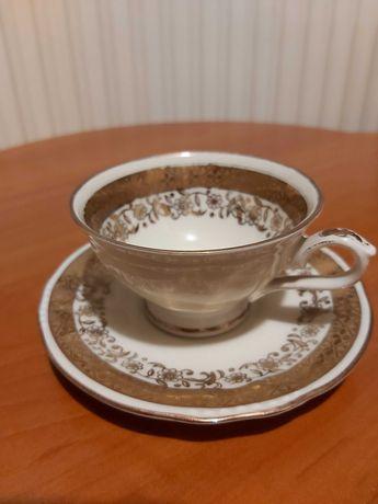 Porcelanowa sygnowana filiżanka z takerzykiem