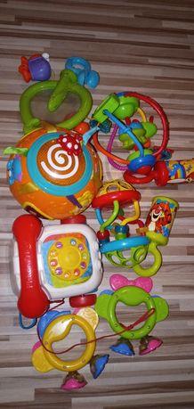 Zestaw zabawek dla niemowlaka. Hula kula grzechotka piszczałka .